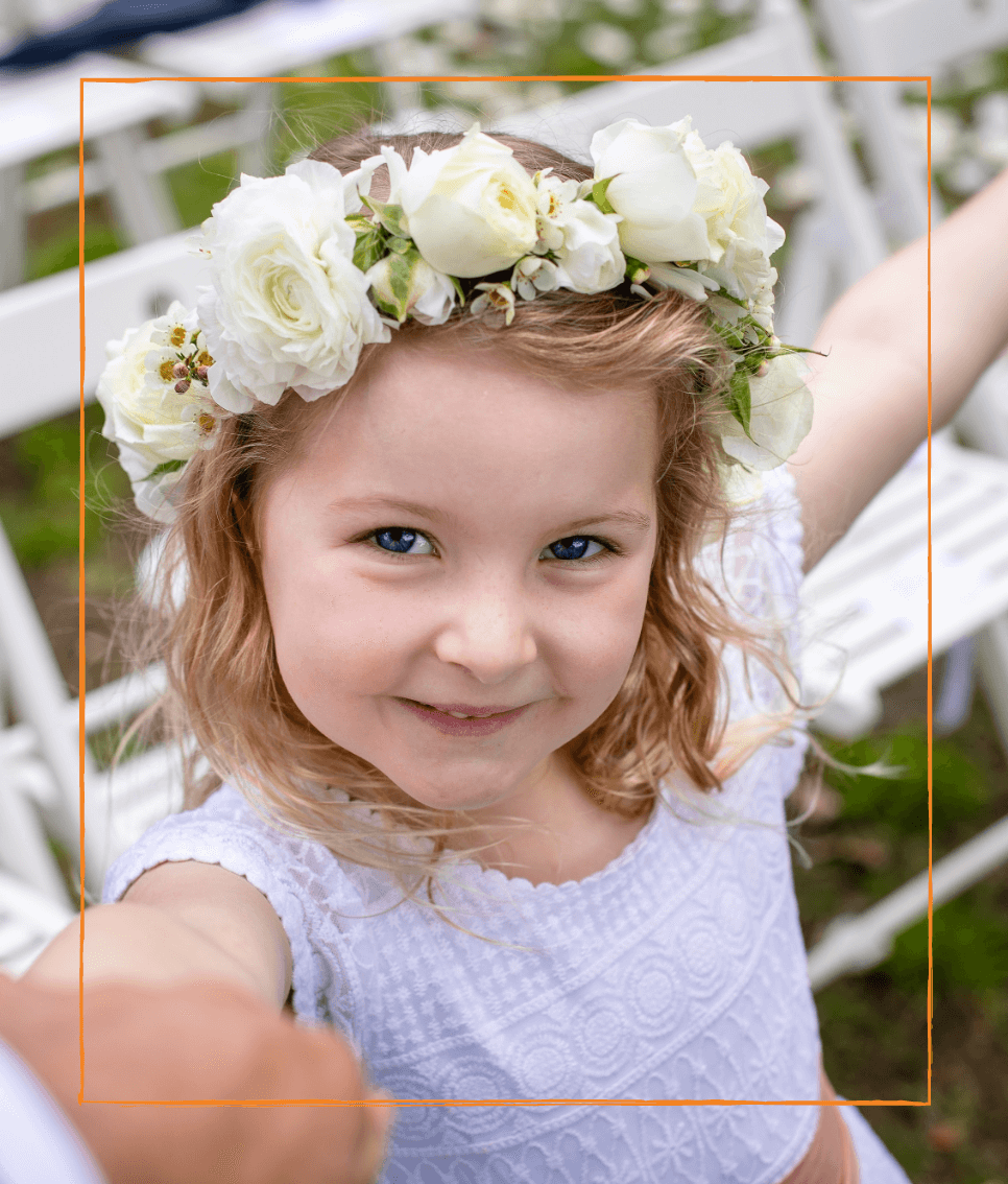 Young girl with a flower headband at a wedding